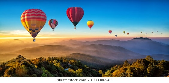 colorful-hot-air-balloons-flying-260nw-1033306540